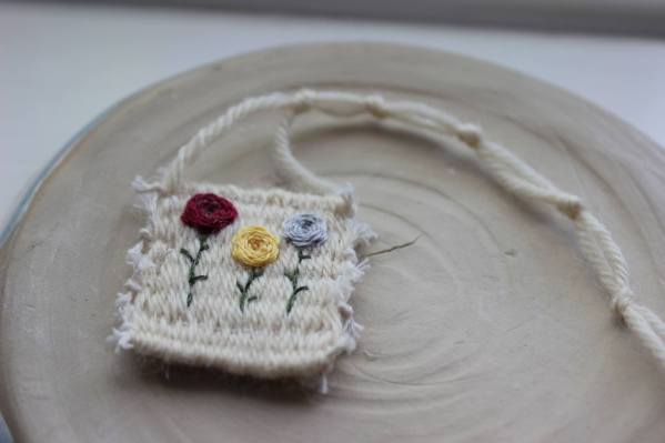 woven mini carpet with embroidered roses